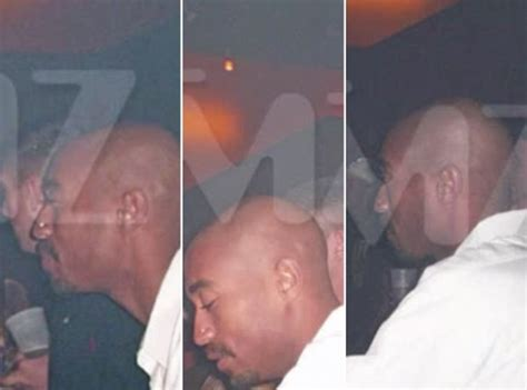 Tupac Is 'Alive' And 'Hiding Tattoos' As Photo Emerges