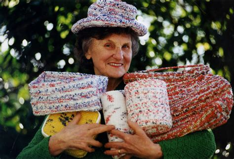 Photograph of Marjorie Bligh with some of her items made