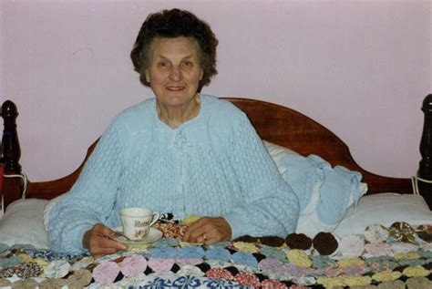 Photograph of Marjorie with her hand-knitted bed Jacket