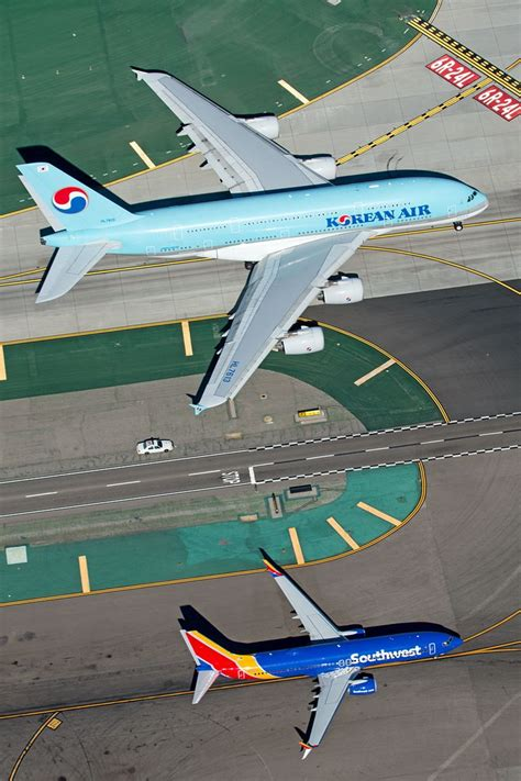 """airviation: """" Photo by Chris Hall """" Airbus A380 vs Boeing"""